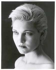 Headshot of a beautiful lady with short blonde hair