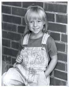 Photograph of a a little girl with blonde hair